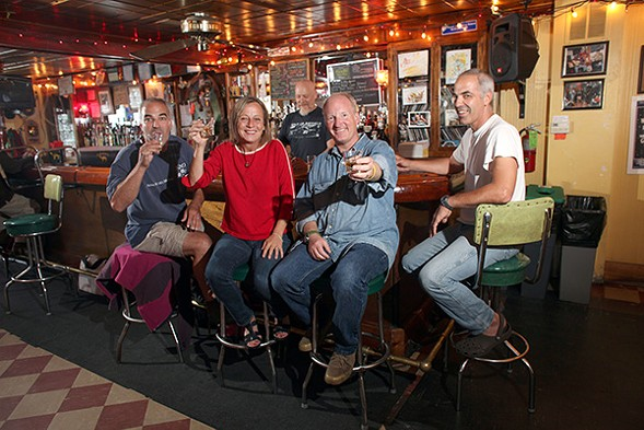 The Hideout's owners celebrate the bar's 15th anniversary in 2011. Brothers Jim and Mike Hinschliff (far left, far right) and married couple Katie and Tim Tuten (center left, center right) bought the bar in 1996. - RICHARD A. CHAPMAN/SUN-TIMES