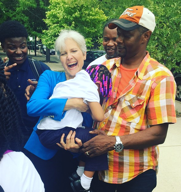 Jill Stein holds the daughter of Austin resident Jonathan Todd. - RYAN SMITH