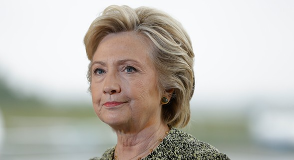 Get in a good Hillary discussion just before the debates at Women & Children First. - AP