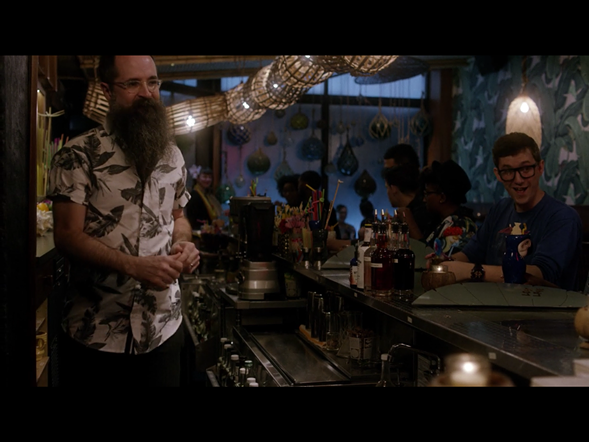 Mixologist Paul McGee takes an order during a date scene at Lost Lake.