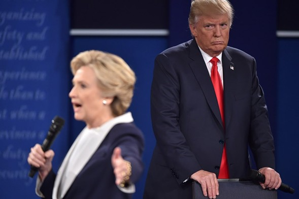 Hillary Clinton and Donald Trump during the second presidential debate - PAUL J. RICHARDS/GETTY IMAGES
