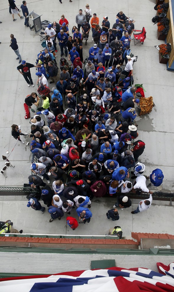 Fans wait to enter Wrigley Field on Sunday. - AP PHOTO/NAM Y. HUH
