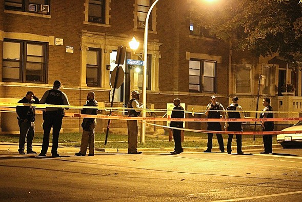 Chicago police officers at the site of a weekend shooting that left one man dead in Woodlawn - DANIEL BROWN/SUN-TIMES