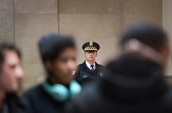 A Chicago police officer outside City Hall in December 2015 - SCOTT OLSON/GETTY IMAGES