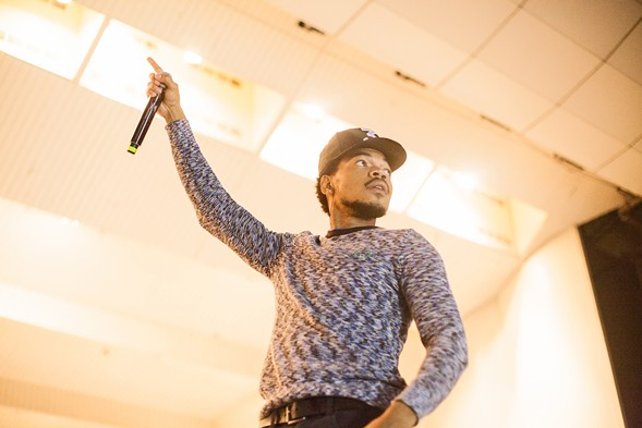Chance the Rapper performed a short set before leading the Grant Park crowd to an early-voting location. - DANIELLE A. SCRUGGS