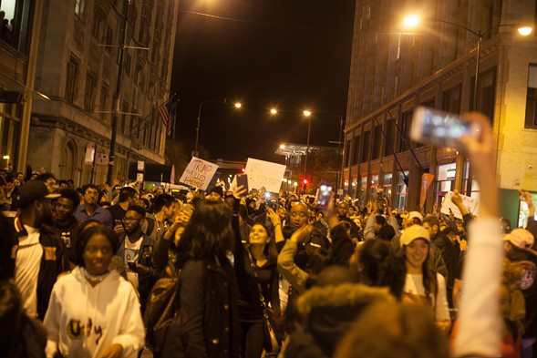 The Grant Park rally heads east into downtown. - DANIELLE A. SCRUGGS