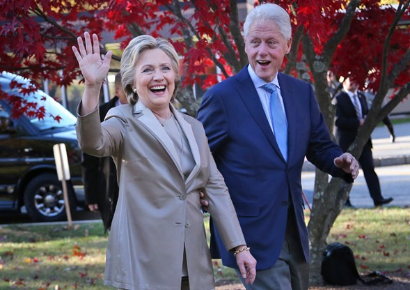 Democratic presidential nominee Hillary Clinton and her husband greet crowds after voting Tuesday in Chappaqua, New York. - AP PHOTO/SETH WENIG