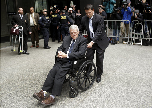 Former House speaker Dennis Hastert leaves the Dirksen federal courthouse in a wheelchair after his sentencing in April. - JOSHUA LOTT/GETTY IMAGES