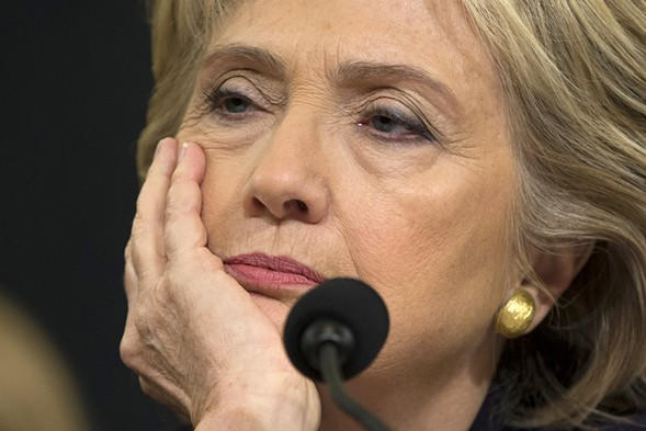 Former Secretary of State Hillary Clinton listens while testifying before the House Benghazi Committee in October 2015. - AP PHOTO/EVAN VUCCI, FILE