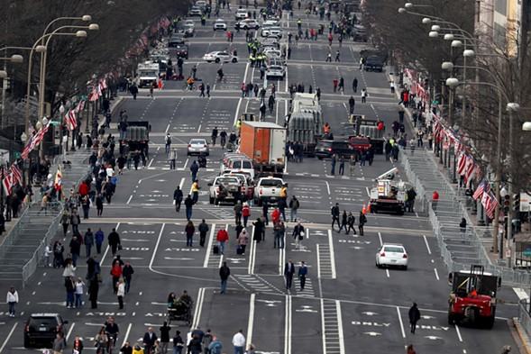 Pennsylvania Avenue in Washington, D.C., bustles on the eve of the presidential inauguration. - JOE RAEDLE/GETTY IMAGES