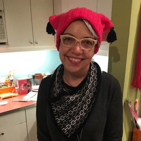 Sister Arts Studio owner Donna Palicka sports her pussyhat. - JACK LADD
