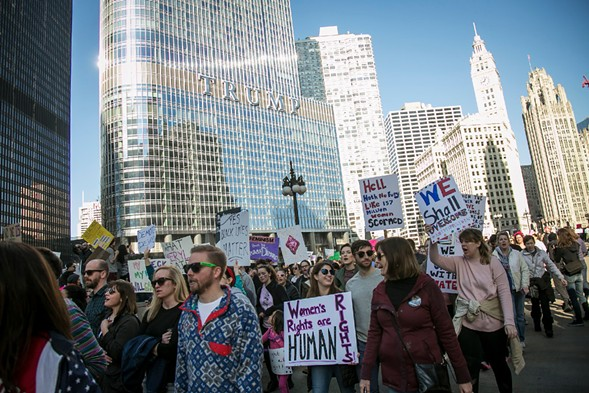 Hundreds of thousands of people protested outside the Trump Tower and in the streets Saturday as part of the Women's March on Chicago. - ASHLEE REZIN/SUN-TIMES
