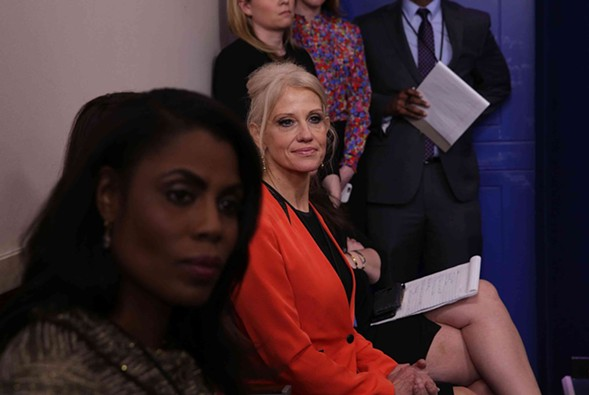 "Senior White House adviser Kellyanne Conway, center listens to press secretary Sean Spicer during a daily briefing. She later defended Spicer by saying he had offered the press ""alternative facts."" - ALEX WONG/GETTY IMAGES"
