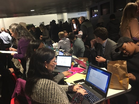 Lawyers worked throughout Saturday evening to free travelers detained at O'Hare. - AIMEE LEVITT