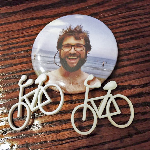 Pins bearing pictures of Bobby Cann were distributed to his family's supporters during last month's sentencing hearing. - BART CROUCH