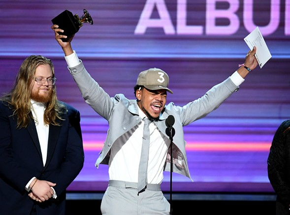 Chance the Rapper accepts the Best Rap Album award for Coloring Book onstage during the Grammy Awards Sunday night. - KEVIN WINTER/GETTY IMAGES
