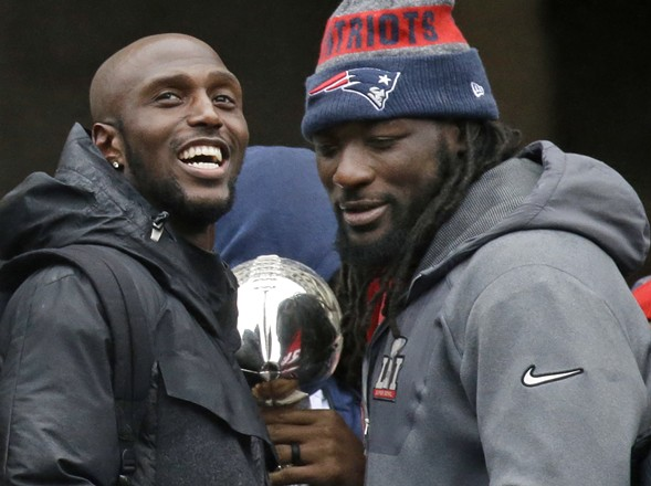 New England Patriots running back LeGarrette Blount, right, is among the Super Bowl winners who've said they won't go to the White House to meet President Donald Trump. - AP PHOTO/ELISE AMENDOLA