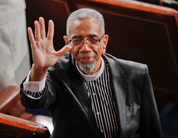 U.S. rep Bobby Rush waves to guests in the balcony as he takes his seat before President Donald Trump's speech before Congress Tuesday night. - AP PHOTO/PABLO MARTINEZ MONSIVAIS