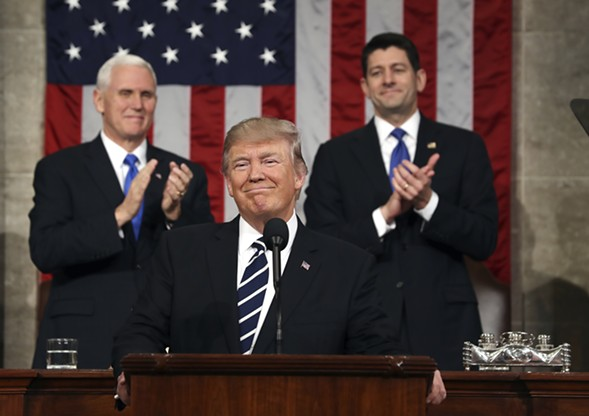 President Donald Trump, flanked by Vice President Mike Pence and House speaker Paul Ryan, at his address to a joint session of Congress Tuesday - JIM LO SCALZO/VIA AP