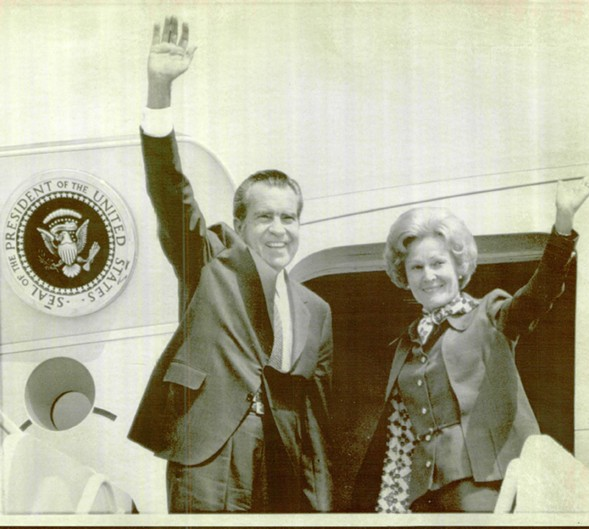 Then-president Richard M. Nixon and First Lady Pat Nixon wave from the ramp of Air Force One during a 1974 trip to Phoenix. - SUN-TIMES ARCHIVE