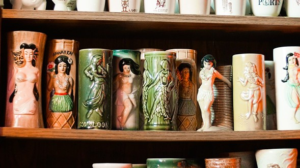 A selection of the Carters' extensive tiki mug collection. - KERRI PANG