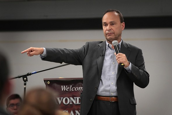 U.S. rep Luis Gutierrez speaks to guest during a town hall meeting on March 6 in Chicago. - PHOTO BY SCOTT OLSON/GETTY IMAGES