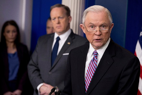 Attorney General Jeff Sessions, accompanied by White House press secretary Sean Spicer, talks to the media at the White House Monday. - AP PHOTO/ANDREW HARNIK