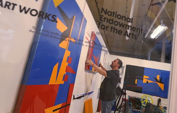 Claudio Roncoli, a recipient of an award from the National Endowment for the Arts, works in his studio space at the Bakehouse Art Complex in Miami, Florida. President Donald Trump has proposed eliminating the NEA and the National Endowment for the Humanities. - JOE RAEDLE