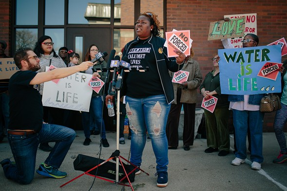 Daniels talks to the media at a rally held last week outside East Chicago mayor Anthony Copeland's office. - ALYSSA SCHUKAR
