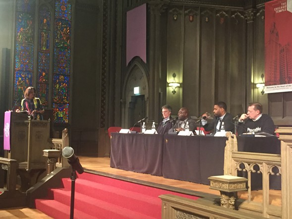 Former TV news anchor Robin Robinson, left, moderated Monday's panel with Cook County sheriff Tom Dart and religious leaders Willie Jennings, Otis Moss, and Michael Pfleger. - RACHEL HINTON