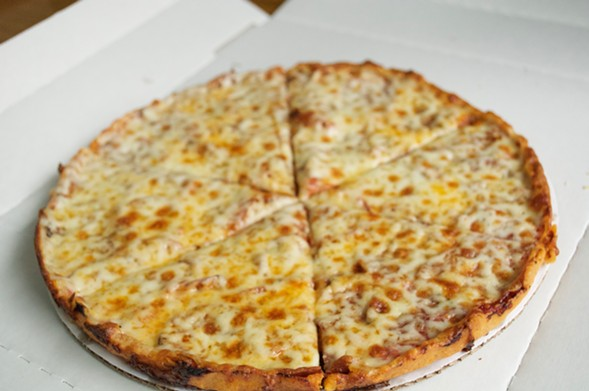 The pizza crust is a very thin, dense, crunchy cracker style - NICK ABAD