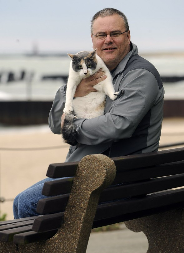 Martin Preib, photographed with his cat, Dill Pickle, in 2010 to promote one of his books, is likely the new media liaison for the Fraternal Order of Police. - AL PODGORSKI/SUN-TIMES