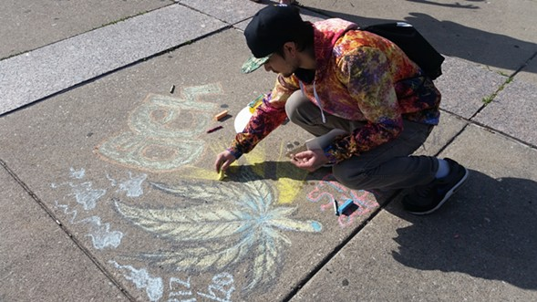 About 80 people gathered at the Logan Square monument Thursday afternoon for a smoke out in honor of 4/20. - LEE GAINES