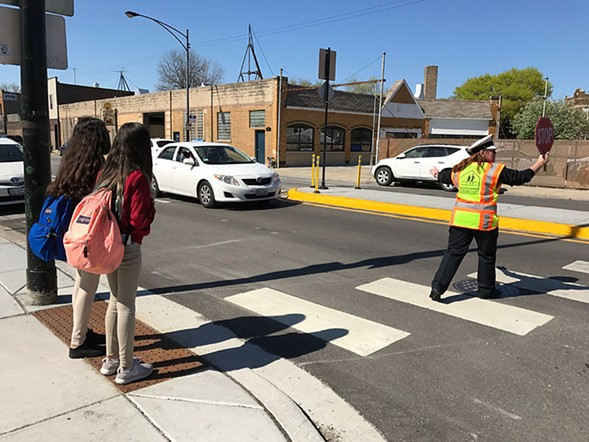 Ana the crossing guard helps Murphy Elementary students safely cross the street. - JOHN GREENFIELD