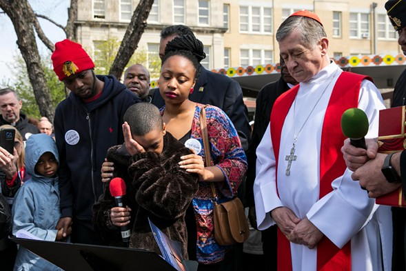 Montrell Davis, 10, breaks down in tears as he talks about Chicago gun violence. Davis and hundreds of people joined Cardinal Blase Cupich in Englewood earlier this month. - ASHLEE REZIN/SUN-TIMES