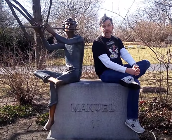 Artist Scott Larson in Graceland Cemetery with the statue that inspired his comic book character Piper Boy. - YOUTUBE
