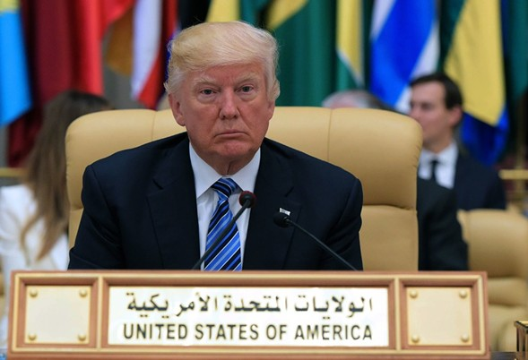 President Donald Trump is seated during the Arab Islamic American Summit in Saudi Arabia. - MANDEL NGAN/AFP/GETTY IMAGES
