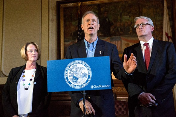 Governor Bruce Rauner, accompanied by senate Republican leader Christine Radogno and house Republican leader Jim Durkin, speaks at a press conference Wednesday. - RICH SAAL/THE STATE JOURNAL-REGISTER VIA AP