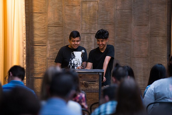 Mauricio Muñoz and Ivan Perez read aloud from their letters to each other - WIL HUGHES PHOTOGRAPHY