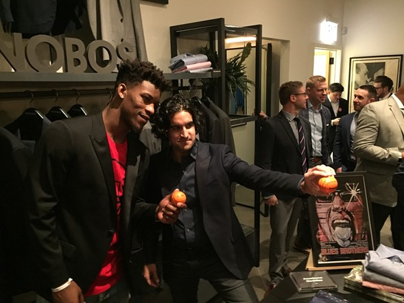 Bonobos CEO Andy Dunn posing with Chicago Bulls star Jimmy Butler during a store opening party in 2016. - RYAN SMITH