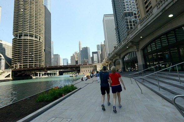 People stroll along the Riverwalk in 2015. - BRIAN JACKSON/FOR THE SUN-TIMES