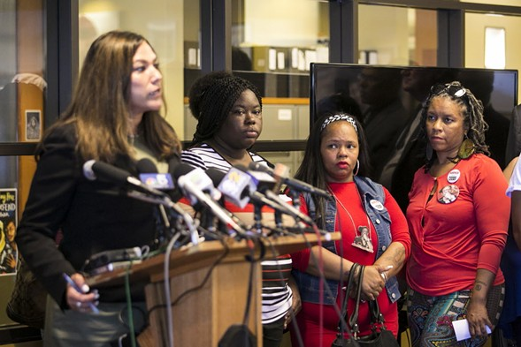 The family of 16-year-old Pierre Loury, who was fatally shot by a CPD officer in April 2016, listen to attorney Sheila Bedi discuss the lawsuit filed last week. - ASHLEE REZIN/SUN-TIMES