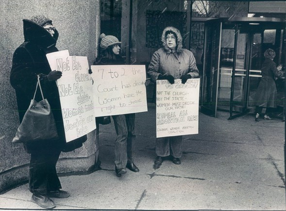 Three representatives of the Illinois Women's Abortion Coalition picket in favor of Roe v. Wade in January, 1973. - FRED STEIN