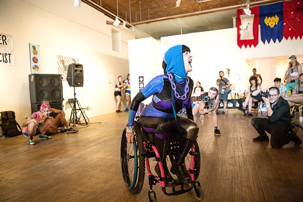 ElleJay Estrada Volpe from Frill-Ability, a local nonprofit serving the disability community, in clothes by Chicago designer Sky Cubacub - ERIC STROM / GLITTERGUTS