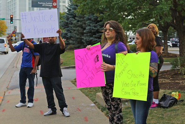 Rally participants outside the Crowne Plaza hotel in Rosemont, where Kenneka Jenkins was found dead in a freezer earlier this month - TIM BOYLE/FOR THE SUN-TIMES