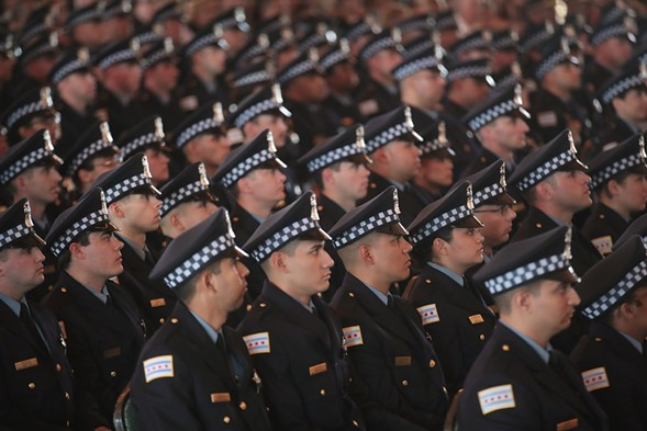 Chicago police officers at a graduation ceremony on Navy Pier in June - PHOTO BY SCOTT OLSON/GETTY IMAGES