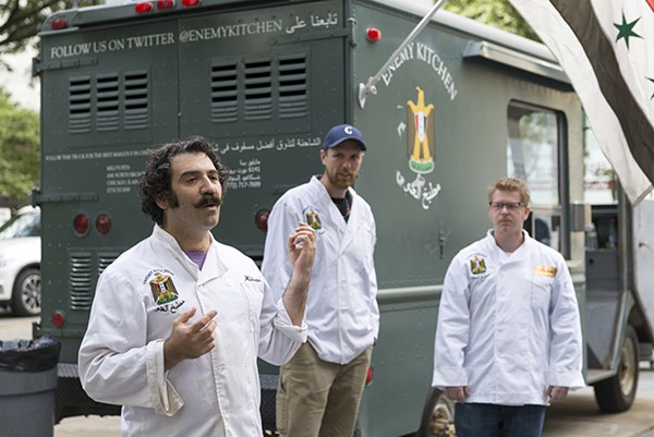 Michael Rakowitz speaks during an October 1 activation of Enemy Kitchen outside the MCA. - NATHAN KEAY/MCA CHICAGO