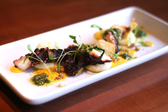 Grilled octopus, pommes puree, aji amarillo vinaigrette, fingerling potato chips, walnut pieces, baby cilantro, and freeze-dried aji amarillo powder - JULIA THIEL