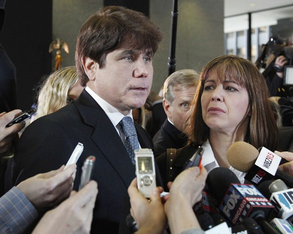 Former governor Rod Blagojevich speaks to reporters as his wife, Patti, listens at the federal building in Chicago in 2011. - AP PHOTO/M. SPENCER GREEN, FILE