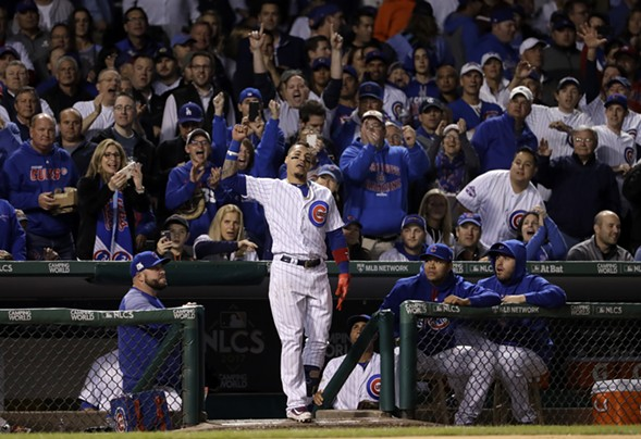 The Chicago Cubs' Javier Baez celebrates after hitting his second home run in game four of the National League Championship Series at Wrigley Field. - AP PHOTO/MATT SLOCUM